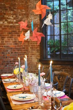pinwheels hanging from the ceiling // photo by Jessica Schmitt, event design by ever swoon