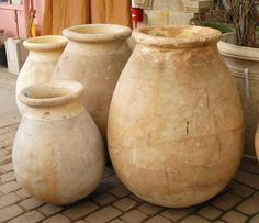 Antique French Oil Jars http://www.eyeofthedaygdc.com/#/products/planters-and-pots/antiques/