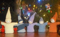 Make a gnome from a felted wool sweater and a wooden bead.
