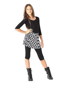 Little ladies will pick this skirt for its print and keep it for its comfort. Coming in a classic cut with an elastic waistband and smooth chiffon-like material, this bottom won't fall short when it comes to function or fashion.