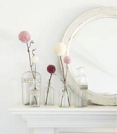 pompom flowers in glass vases