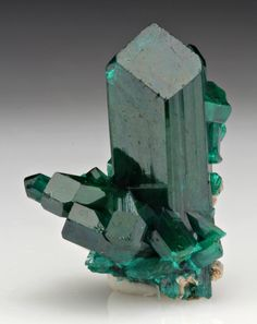 """Dioptase is a stone of healing that has a refreshing energy. It can help heal in many ways emotionally, including helping get one started clearing one's issues, and releasing negative emotions. It promotes healing from abuse, neglect, sadness, and despair. It is called a stone of """"Living in the Moment"""" because it helps one overcome these hurtful past energies and find the joy of the current moment, bring calm, confidence, and self-worth."""