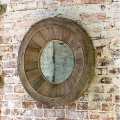 A thick circular frame of wood encases an inset frame of smaller wood slats in a starburst formation. Rustic, yes, but with a very Zen appeal that would complement any design style. brbrliDimens...