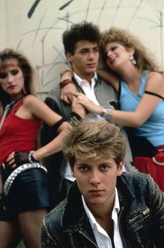 80s James Spader; and, I think that is Robert Downey, Jr. in the background