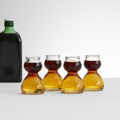 Quaffer Shot Glass Set - These patented Quaffer double bubble shot glasses are the life of the party. Designed specifically for bomb shots, liquor goes on top while chaser goes in the bottom. Like magic the liquids will stay separate until revelers are ready to pound a shot or two.
