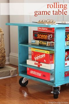 Coffee table transformed into a Rolling Game Table or even a portable fireside dining table.  { In My Own Style.com}
