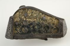Animal-head brooch. Bronze, silver and gold. The brooch has elaborate ornamentation and is proof of a high standard craftsmanship. Grave find, Hemse, Annexhemman, Gotland, Sweden.  SHM 4645