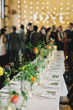 simple (and impactful) centerpieces, photo by Clean Plate Pictures http://ruffledblog.com/stylish-green-building-wedding #weddingideas #weddingcenterpieces