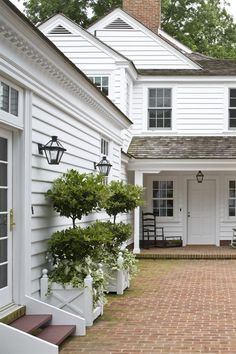 white houses, white exterior house, dream, brick patio, bricks, topiari, brick clapboard house, planter boxes, historic homes