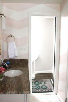 pink chevron walls / dark green / bathroom