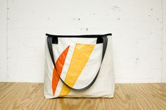 Bags made from recycled sails and other materials, from Teamwork in Grand Rapids...