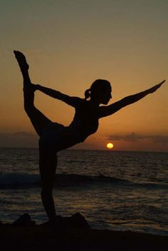 yoga pose at sunset