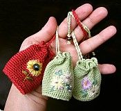 Slovak picture of tiny embroidered crochet bags --  no pattern