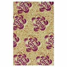 Wool rug with an oversized floral motif. Hand-tufted in India.  Product: RugConstruction Material: 100% WoolColor: MultiFeatures:  Made in IndiaHand-tufted  Note: Please be aware that actual colors may vary from those shown on your screen. Accent rugs may also not show the entire pattern that the corresponding area rugs have.Cleaning and Care: These rugs can be spot treated with a mild detergent and water. Professional cleaning is recommended if necessary.