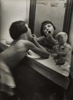 'At the Vanity'.  Photographed by Rogi André, circa 1929 | 1920s | cute | make up | vintage | black & white | vanity | mirror mirror on the wall | little girl playing |