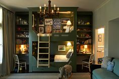This bunk bed unit is so inventive with its incorporation of small desks and shelves on each side. Going vertical makes fantastic sense for a small room.