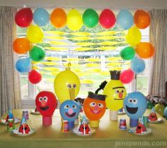 Sesame Street balloon characters and a budget party theme