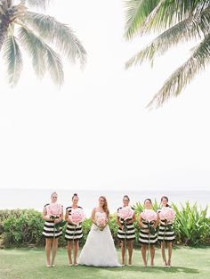 striped bridesmaid dresses with paper flowers, photo by Ashley Goodwin http://ruffledblog.com/kate-spade-inspired-wedding-in-hawaii #weddingideas #bridesmaids