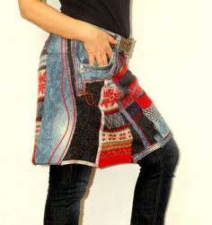 Funky upcycled denim and sweater knit apron wrap skirt worn with leather belt for closure. From etsy seller jamfashion.