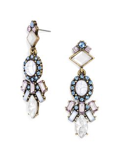 Organic white stones take center stage in these statement earrings, accented by dramatic, sharp-edged stone work in a cool color palette of purple and blue.