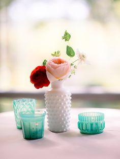 milk glass arrangements, photo by TIMWILL http://ruffledblog.com/romantic-southern-wedding #flowers #centerpieces #milkglass
