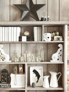 Nearly free acquisitions—vintage glass bottles, old clocks and cameras, and architectural brackets—populate the bookcase.