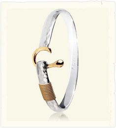 Long ago, on the Virgin Islands, a girl fell in love with a sailor,  they were to marry. She wanted to give him a wedding gift that would signify their love, but ringson a scarcely populated Islandwere not an option. So, she raided his tackle box for fishing hooks and heavy leader,  the first Hook bracelet was born. This meant they were hooked to each other in love, and the tradition remains. If the open hook is worn facing the heart, it means you have foun