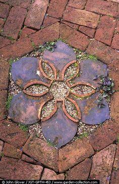 Patio ~ Decorative focal point in garden brick path