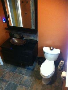 bathroom with slate floor walls burnt orange walls