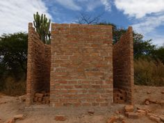 11. Just weeks after work began, the first of the latrines has begun to resemble a latrine block!
