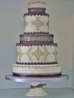 Purple Wedding Cake - beautifully decorated purple wedding cake.