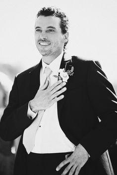 groom seeing bride coming down aisle