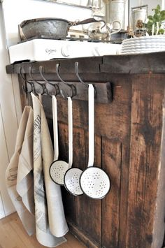 Love these ladles and farmhouse hooks.