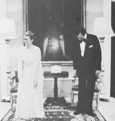 Princess Grace making a bob to the Queen Mother at St. James's Palace, 1978. The other poetry-reader is Richard Pasco of the Royal Shakespeare Company.