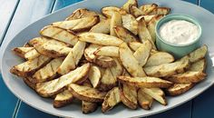 """Steak Fries with Rosemary-Lemon Aioli: """"Grill the potato slices over direct medium heat, with the lid closed, until tender and marked by the grill, 15 to 17 minutes, turning occasionally."""" side dish for grilled steak, steak fri"""