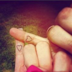 27 Heart-Melting Sister Tattoos // pinky promise heart tattoos
