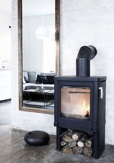 . wood burning stoves, cabin, living rooms, fireplac, modern interior design, wood storage, future house, old wood, wood stoves