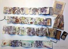 Little accordion books, eco-printed, gelli printed and fabric and findings added. Housed in vintage tins.