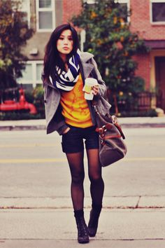 Relaxed chic, working the yellow t-shirt, grey blazer, shorts and tights look.  Love everything about it.  www.nakedhealthspa.com #yellow #streetchic #boots