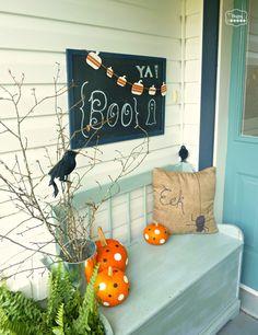Halloween front porch with polka dot pumpkins crows chalkboard art at thehappyhousie #Halloween decorating #Haloween door hanging #Halloween Outdoor decor #Halloween porch
