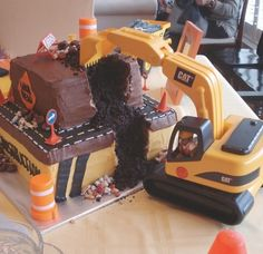 Thinking I can't wait for his next birthday to make this - he will love using a real excavator to dig up the cake. fun digger cupcakes, digger birthday cake, birthday parties, boy birthday cake construction, bob the builder birthday cake, cake digger, boy birthday cakes, digger cake, digger birthday party
