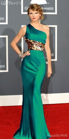Flippin love this dress. Taylor Swift in a unique emerald one shoulder #gown with leopard sash #TheCroods