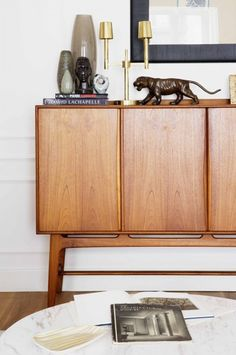 A midcentury modern sideboard, marble table