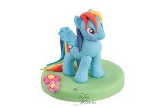 Cute little pony tutorial here: http://cake.corriere.it/2013/08/30/rainbow-dash-tutorial/