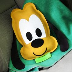 Back seat passengers will get a lot of mileage out of this cuddly Pluto travel pillow.