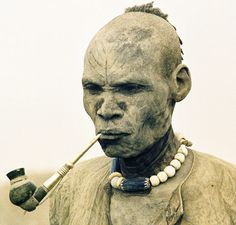 "Dinka Man, Sudan    ""A Dinka elder's pallid body, caked in ash, and his great height earned him the name 'ghostly giant' from early explorers into Sudan. Wise in the ways of cattle husbandry, he is one of the oldest herders in the cattle camp and is consulted on important issues of survival during the long dry season.""    photographers Carol Beckwith and Angela Fisher"