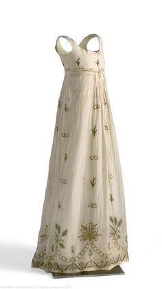 Dress: ca. 1795-1805, batiste, embroidered with sequins and floral theme. Search for CE000566A.