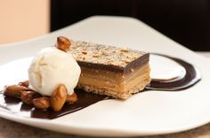 The Candy Bar:  Pretzel Cookie Crust, Peanut Butter Mousse, Caramel, Chocolate Ganache, Vanilla Ice Cream