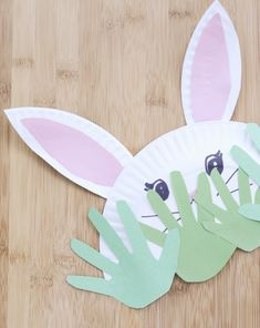 Construct a bashful paper #bunny with your little bunny this #Easter, out of #paperplates and #handprints! #kids #craftsforkids #crafts
