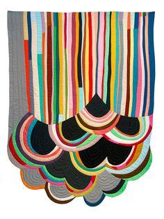 A gorgeous rainbow quilt.